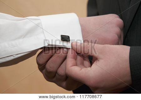 Each Wears Cufflinks On The Sleeves Of The Groom