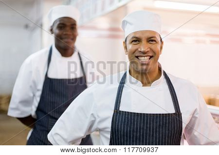 happy middle aged butchery owner and worker