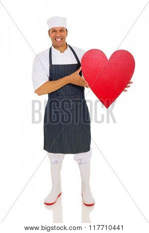 happy middle aged chef holding heart shape on white background