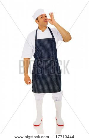 middle aged chef making delicious hand sign