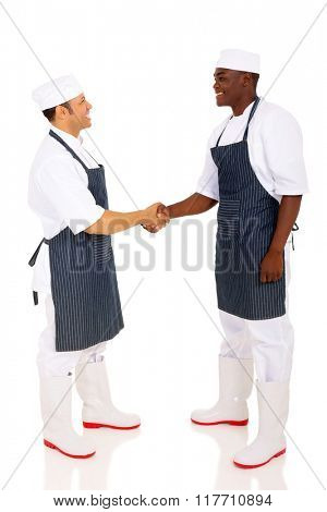 friendly male chefs hand shaking isolated on white background