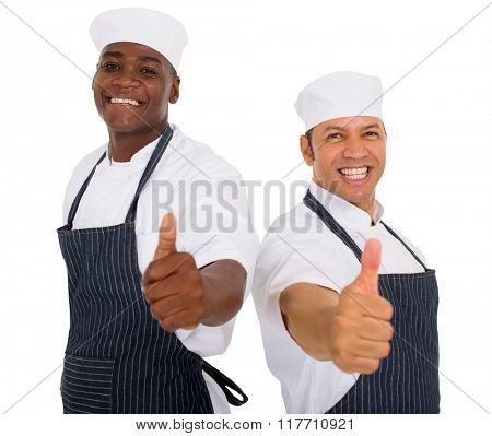 professional male butchers giving thumbs up