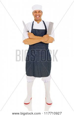 cheerful middle aged male butcher holding knives
