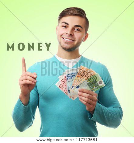 Man holding money on green background