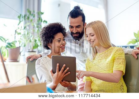 business, technology, startup and people concept - happy creative team with tablet pc computers in office
