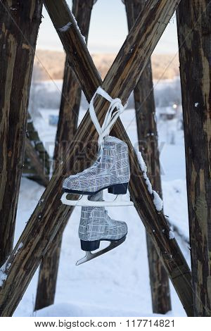 Freestyle ice skate boots with blades, winter sport and leisure concept. Winter landscape background