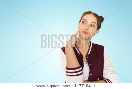 people and teens concept - happy pretty teenage girl thinking over blue background