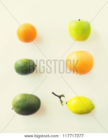 diet, eco food, healthy eating and objects concept - ripe fruits and vegetables over white
