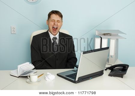 Businessman Yawning From Boredom And Idleness