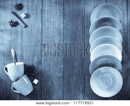 empty  cup and saucer on wooden background