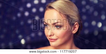 people, beauty, spa, healthy lifestyle and relaxation concept - close up of beautiful young woman sitting in bath towel