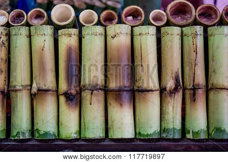 Glutinous Rice Roasted In Bamboo Joints.