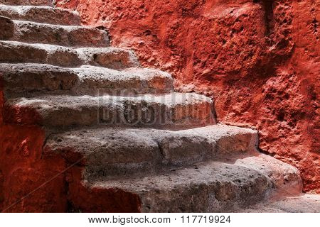beautiful old steps and red wall