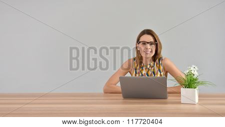 Beautiful woman working on laptop, isolated