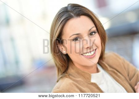 Portrait of beautiful brunette woman in city street