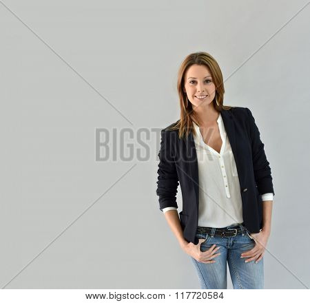 Beautiful woman standing on grey background
