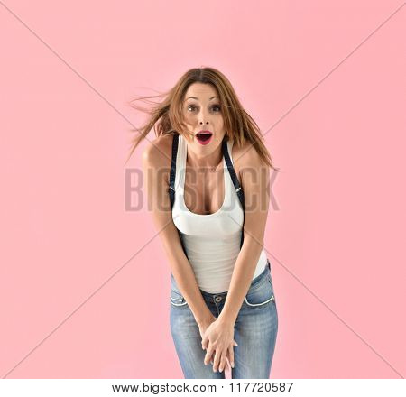 Trendy girl with suspenders moving on pink background