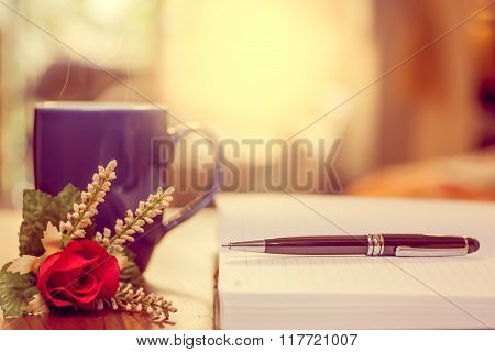 Pen On Notebook And Coffee Cup, Flower.