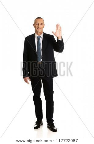 Full length businessman pressing abstract screen