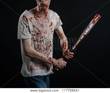 Bloody Topic: The Guy In A Bloody T-shirt Holding A Bloody Bat On A Black Background