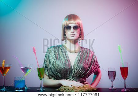 Woman Wearing Sunglasses Standing At Bar In Disco