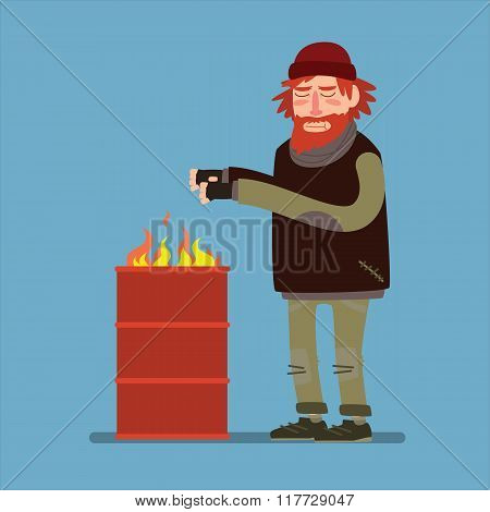 Sad homeless heated standing near barrel with fire