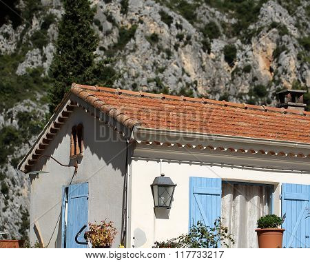 Small Cottage With Blue Shutters
