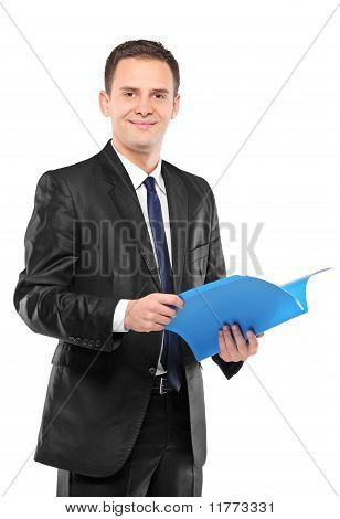 Confident Businessman In Black Suit Holding Documents