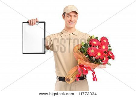 Delivery Boy Holding A Bouquet Of Flowers And Clipboard