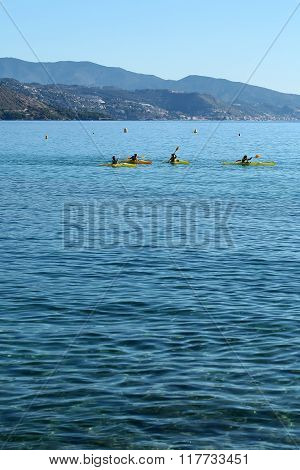 People Rowing Yellow Canoes