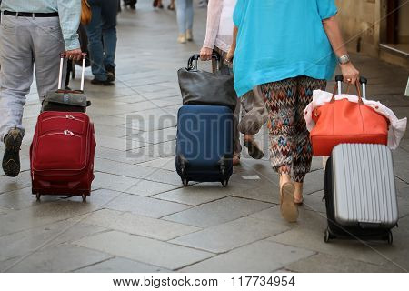 People Rolling Wheeled Travel Bags