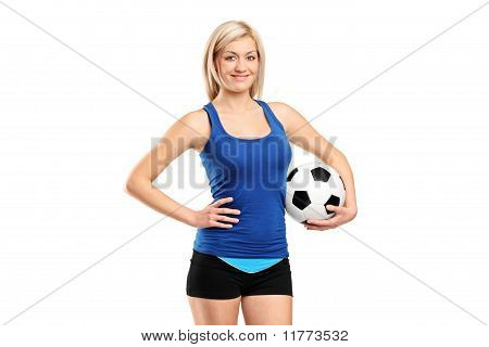 Attractive Female Holding A Football