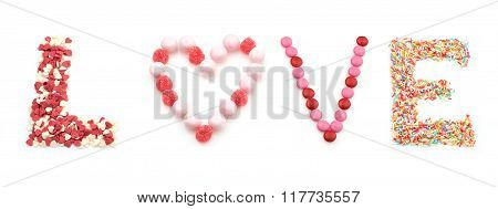 sweet word love made of candies on white background