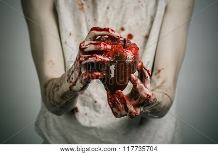 Bloody Halloween Theme: Crazy Killer Keeps Bloody Hands Torn Bloody Human Heart And Experiencing Dep
