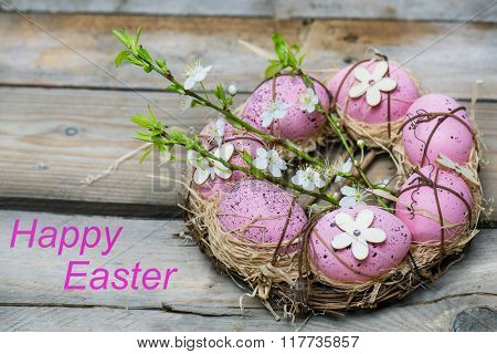 Pink eggs, symbol of Easter, lying in a nest