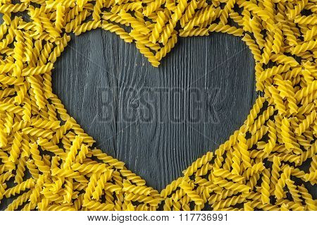 Heart shape made of fusilli. Italian cuisine.