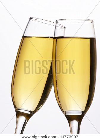 Two champagne glasses in toast