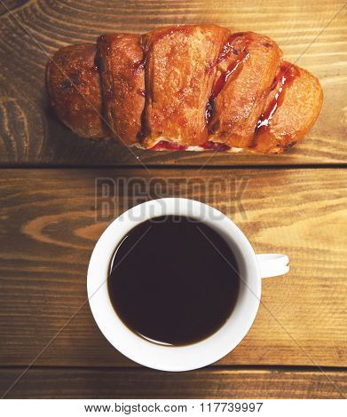 Coffee cup, dessert on wooden table