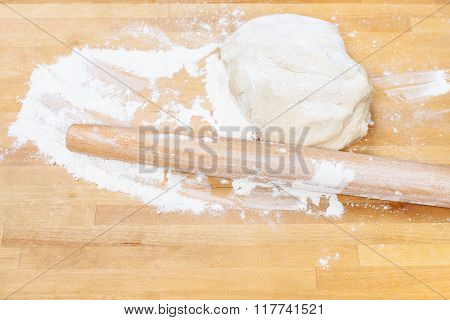 Flour, Rolling Pin And Kneading Dough On Table
