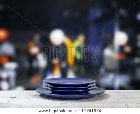 plates on white table in a night club