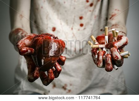 Social Advertising And Tobacco Control: Bloody Hand Holding A Cigarette Smoker And Bloody Human Hear