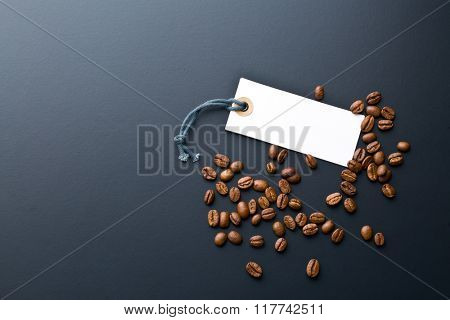 coffee beans and price label on black background