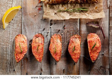 Baked Mussels on Wooden Background