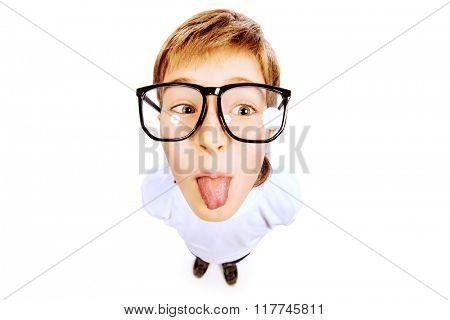 Funny smart boy wearing big glasses. Education. Optics. Studio shot. Isolated over white.