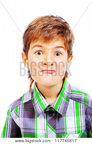 A boy looks at the camera and makes faces. Isolated over white.