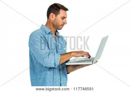 Man using laptop standing on white screen