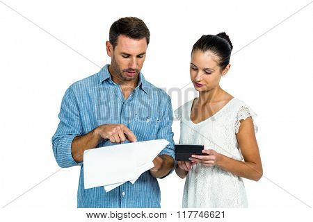 Couple calculating bills on white screen