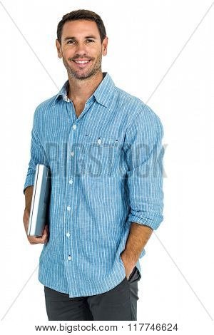 Smiling man holding laptop looking at the camera on white screen
