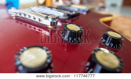 Close up of electric guitar volume knob