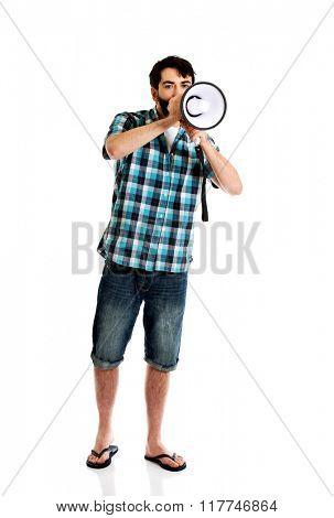 Young man shouting through megaphone.